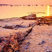 Rocky coast of the harbor at sunrise. Rockland, Maine