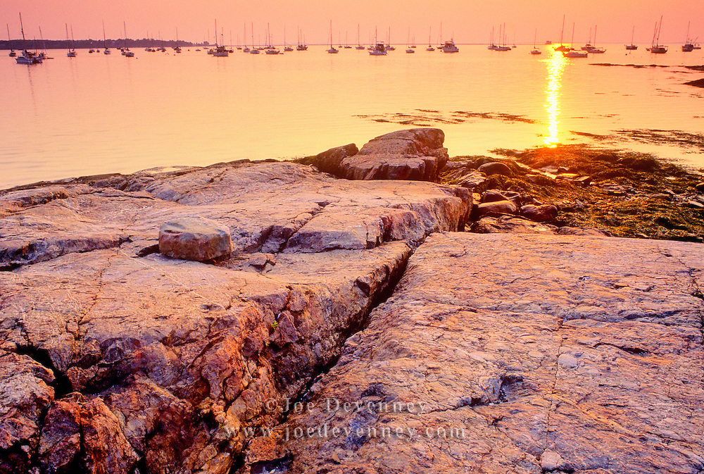 Rocky coast of the harbor at sunrise. Rockland, Maine