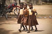 Three girls in school uniforms walking together.Northern Ghana, Wednesday November 12, 2008.
