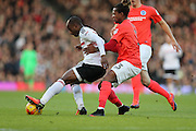 Fulham striker Sone Aluko (24) and Brighton & Hove Albion full back Gaetan Bong (3) during the EFL Sky Bet Championship match between Fulham and Brighton and Hove Albion at Craven Cottage, London, England on 2 January 2017.