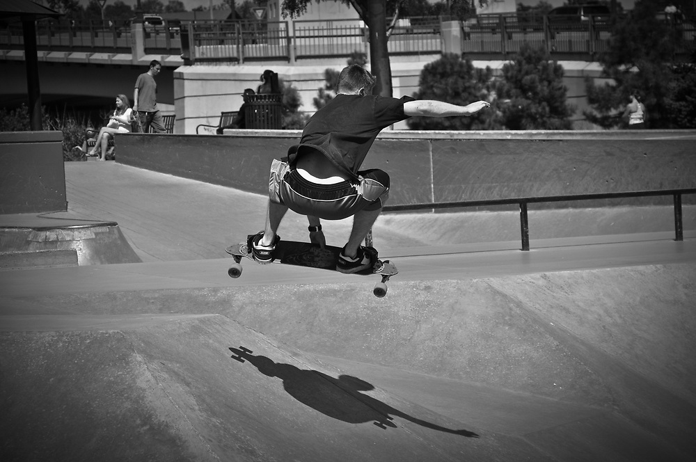 A picture of a skate boarder doing jumps and tricks in Denver Colorado.<br />