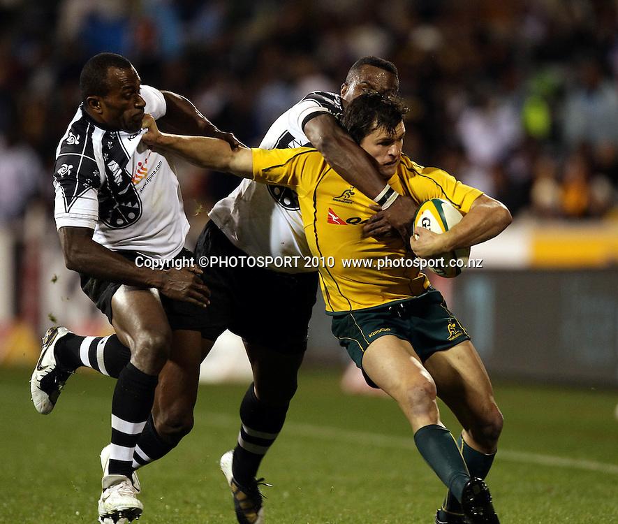 Adam Ashley Cooper tacklde by Rupeni Caucaunibuca<br /> <br /> International Test rugby union match, Australia v Fiji, Canberra, Australia. Saturday 5 June 2010. Photo: Paul Seiser/PHOTOSPORT