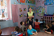 Tunisian Jewish school teacher Nrguila Achouche, ,21, at the Beit Rachel Kindergarten school located in the Hara Kebira  neighborhood on the Tunisian island of Djerba on May 25,2016.  Five years after Tunisia's revolution, and a year after three deadly ISIS attacks, the 1,100 Jews in this tiny island community of Djerba say they do not feel threatened living in Tunisia.(Photo by Heidi Levine).