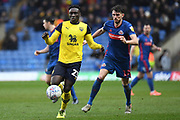 Oxford United forward Dan Agyei (23) battles for possession  with Sunderland defender Tom Flanagan (12) during the EFL Sky Bet League 1 match between Oxford United and Sunderland at the Kassam Stadium, Oxford, England on 15 February 2020.