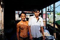 A portrait of two fishermen in the Mekong Delta, southern Vietnam.