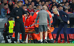 Arsenal manager Arsene Wenger speaks with Arsenal's Laurent Koscielny as he is stretchered off during the UEFA Europa League, Semi Final, Second Leg at Wanda Metropolitano, Madrid.