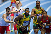 (L) Lukasz Krawczuk with his teammate (2L) Partyk Dobek   and (C) Dane Hyatt of Jamaica and (R) Kind Butler III of USA compete in men's relay 4x400 meters qualification during the IAAF Athletics World Indoor Championships 2014 at Ergo Arena Hall in Sopot, Poland.<br /> <br /> Poland, Sopot, March 8, 2014.<br /> <br /> Picture also available in RAW (NEF) or TIFF format on special request.<br /> <br /> For editorial use only. Any commercial or promotional use requires permission.<br /> <br /> Mandatory credit:<br /> Photo by &copy; Adam Nurkiewicz / Mediasport