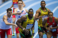 (L) Lukasz Krawczuk with his teammate (2L) Partyk Dobek   and (C) Dane Hyatt of Jamaica and (R) Kind Butler III of USA compete in men's relay 4x400 meters qualification during the IAAF Athletics World Indoor Championships 2014 at Ergo Arena Hall in Sopot, Poland.<br /> <br /> Poland, Sopot, March 8, 2014.<br /> <br /> Picture also available in RAW (NEF) or TIFF format on special request.<br /> <br /> For editorial use only. Any commercial or promotional use requires permission.<br /> <br /> Mandatory credit:<br /> Photo by © Adam Nurkiewicz / Mediasport