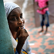 Senegal October 25, 2006 - Woman waiting in front her house in a poor suburb of Senegal's capital ©Jean-Michel Clajot