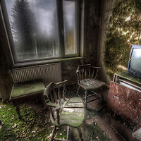 Old very moldy hotel. <br /> Hotel Schimmelig interior with chairs and television