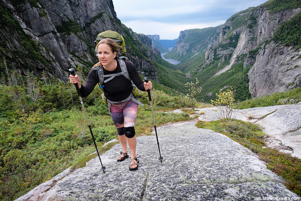 A woman backpacking in Gros Morne National Park, Newfoundland, Canada.