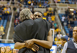 Nov 23, 2015; Morgantown, WV, USA; West Virginia Mountaineers forward Jonathan Holton (1) hugs West Virginia Mountaineers head coach Bob Huggins during senior night ceremonies before their game against the Texas Tech Red Raiders at WVU Coliseum. Mandatory Credit: Ben Queen-USA TODAY Sports