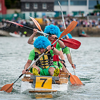 REPRO FREE<br /> The crew from Herbal Life paddling away at the RNLI Raft Race in Kinsale on Saturday of the Bank Holiday Weekend<br /> Picture. John Allen