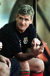 MINSK, BELARUS - Saturday, September 4, 1999: Wales's manager Mark Hughes sits on the bench for his first game in charge during the UEFA Euro 2000 Qualifying Group One match against Belarus at the Dinamo Stadium. (Mandatory credit: David Rawcliffe/Propaganda)