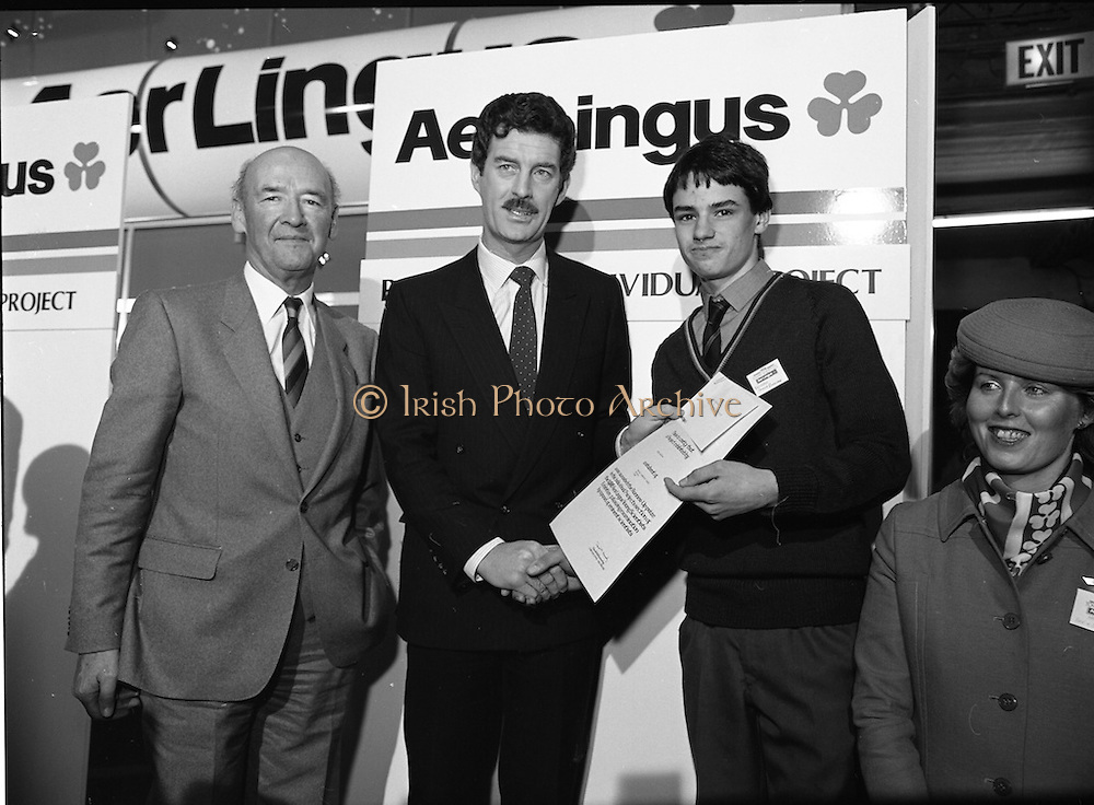 10/01/1986.01/10/1986.10th January 1986.The Aer Lingus Young Scientist of the Year Exhibition at the RDS, Dublin...Picture shows Con Power, (left) Director, Economic Policy, Confederation of Irish Industries, presenting the CII Award for the Physical, Mathematical and Applied Sciences, Intermediate Pupils, to Brian Gribben of St. Olcan's Secondary School, Randlestown, Co. Antrim. Also pictured is Niall G. Weldon, Chairman of the Panel of Judges. Brian's winning project was entitled 'Computer Controlled Pig Feed Unit'. Also pictured (left) is Michael Dargan, Chairman of Aer Lingus. ..