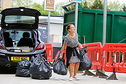 © Licensed to London News Pictures. 13/05/2020. London, UK. A woman with household rubbish at Western Road Reuse & Recycling Centre in Haringey, north London which opened this morning after seven weeks of the coronavirus lockdown. Photo credit: Dinendra Haria/LNP