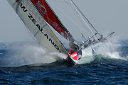 Emirates Team New Zealand, NZL82 powers through a wave on approach to the top mark in their match against Victory Challenge, SWE63. Louis Vuitton Act 6. Malmo, Sweden. 29/8/2005