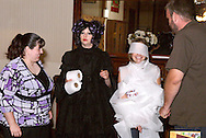"Tamra Francis (2nd from left) talks after audience members turn Tara Moore of Dayton into a 'mummy' during Mayhem & Mystery's production of ""Costume Carousing"" at the Spaghetti Warehouse in downtown Dayton, Monday, September 12, 2011."
