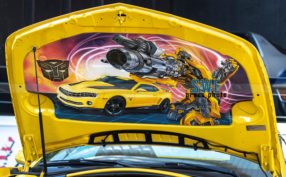 2018-07-04 | Huskvarna, Sweden: The hood of a 2012 Chevrolet CAMARO 6.2 V8 (Bumblebee) during the car meet in Huskvarna Folkets Park ( Photo by: Marcus Vilson | Swe Press Photo )<br /> <br /> Keywords: , Huskvarna, Huskvarna Folkets Park, Camaro, Corvette, Cars, Power, Muscle, Enthusiast, Motor, Engine, People, USA, Sweden, Chevrolet, Bumblebee