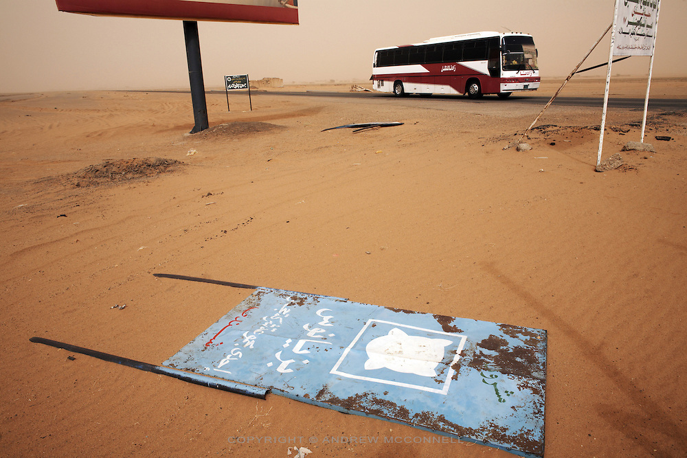 A bus travels along the Khartoum-Atbara highway during a sandstorm on Friday, March 30, 2007.  With Chinese investment road building is turning former desert tracks into paved highways.