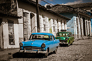 Two Cuban Vintage 1950s Cars on the street in Trinidad, Cuba