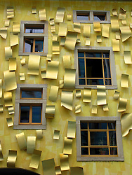 Yellow walls and decoration  on apartment building in the Kunsthofpassage courtyards in Dresden Germany  The series of courtyards have been specially designed by different architects on different themes