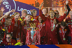 LIVERPOOL, ENGLAND - Wednesday, July 22, 2020: Liverpool's captain Jordan Henderson (C) celebrates with the Premier League trophy as the Reds are crowned Champions after the FA Premier League match between Liverpool FC and Chelsea FC at Anfield. The game was played behind closed doors due to the UK government's social distancing laws during the Coronavirus COVID-19 Pandemic. Dejan Lovren, goalkeeper Caoimhin Kelleher, Joe Gomez, Virgil van Dijk. (Pic by David Rawcliffe/Propaganda)