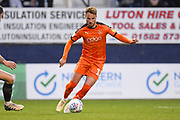 Luton Town player Andrew Shinnie moves the ball into the box in the first half during the EFL Sky Bet League 1 match between Luton Town and AFC Wimbledon at Kenilworth Road, Luton, England on 23 April 2019.
