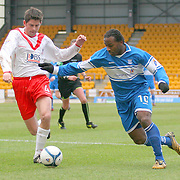 Airdrie Utd's Stuart Taylor and St johnstone's Jason Scotland in action in the Scottish First Division match played at McDiarmid Park 20th January 2007.