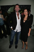 MAT COLLISHAW AND ALISON JACQUES, private view  of new exhibition by Tim Stoner , Alison Jacques Gallery in new premises in Berners St., London, W1 ,Afterwards across the rd. at the Sanderson Hotel. 3 May 2007. DO NOT ARCHIVE-© Copyright Photograph by Dafydd Jones. 248 Clapham Rd. London SW9 0PZ. Tel 0207 820 0771. www.dafjones.com.