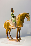 Sancai pottery figure on horseback on display in the Shanghai Museum, China