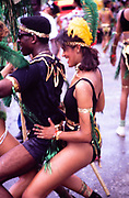 People in procession dancing on streets at Easter carnival, Kingston, Jamaica, West Indies in 1990