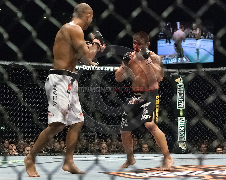 "NEWCASTLE, ENGLAND, UNITED KINGDOM, JANUARY 19 2008: BJ Penn (left) faces off against a bloodied Joe Stevenson during ""UFC 80: Rapid Fire"" inside the Metro Radio Arena in Newcastle, England on January 19, 2008."