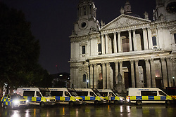 London, UK. 14 October, 2019. Metropolitan Police vehicles outside St Paul's cathedral during a protest in the City of London by climate activists from Extinction Rebellion on the eighth day of International Rebellion protests.