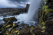 Öxarárfoss is a waterfall in Þingvellir National Park, Iceland. It flows from the river Öxará over the Almannagjá canion.