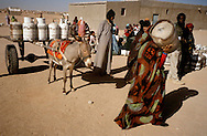 The Saharawi refugee camp  ..El Ayoun.Supply of gas tank.January 2008