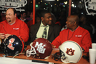 Lafayette High quarterback Jeremy Liggins (center), with hosts Ronnie Williams (left) and Fred Johnson, announces he will attend LSU during the Collier Dental Sports Roundup at the Irie in Oxford, Miss. on Monday, January 30, 2012.