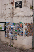"Postcards are displayed on racks, on Rua de Sao Joao da Praca, a corner in the medieval district of Alfama, on 11th July, in Lisbon, Portugal. The national flag makes an appearance too, the day after Portugal won the final against France in the Euro 2016 football tournament. Alfama partly has its roots from Moorish influences and is the oldest district of Lisbon. Its name comes from the Arabic Al-hamma but could also be derived from the Arabic word Alfamm, meaning the ""mouth"" in Arabic. (Photo by Richard Baker / In Pictures via Getty Images)"
