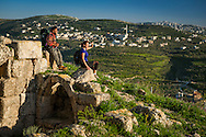 Palestine, March 2015. Sebastia offers thousands of years of local history. The town is built on the site of the biblical city of Samaria. Atop the archaeological hill, surrounded by Roman ruins, a Greek Orthodox church marks the site associated with the discovery of John's head. The Abraham Path is a long-distance walking trail across the Middle East which connects the sites visited by the patriarch Abraham. The trail passes through sites of Abrahamic history, varied landscapes, and a myriad of communities of different faiths and cultures, which reflect the rich diversity of the Middle East. Photo by Frits Meyst / MeystPhoto.com for AbrahamPath.org