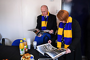 AFC Wimbledon legend Ian Cooke looks over the plans for the new stadium during the AFC Wimbledon Demolition Event, marking the start of building works at the AFC Wimbledon Stadium Site, Plough Lane, United Kingdom on 16 March 2018. Picture by Stephen Wright.