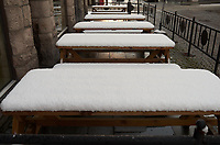 Outdoor dining tables covered with snow. Walkabout while the ship was docked in Ålesund. Image taken with a Leica X2 camera