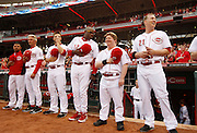 Thursday, April 18, 2013 REDS SPORTS : Cincinnati Reds manager Dusty Baker talks with guest bat boy Teddy Kremer  during the National Anthem before their game against the Miami Marlins at Great American Ball Park. The Enquirer/Jeff Swinger