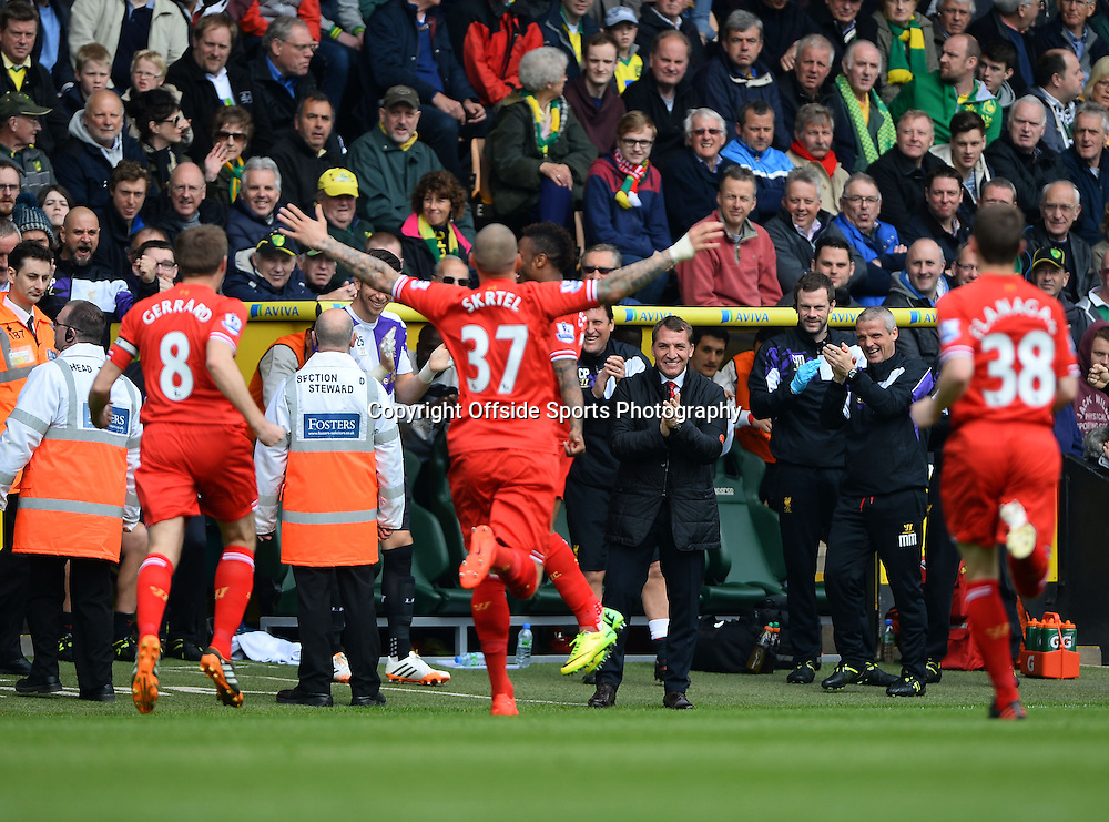 20 April 2014 - Barclays Premier League - Norwich City v Liverpool - Liverpool Manager, Brendan Rodgers applauds as his players celebrate the 1st goal - Photo: Marc Atkins / Offside.