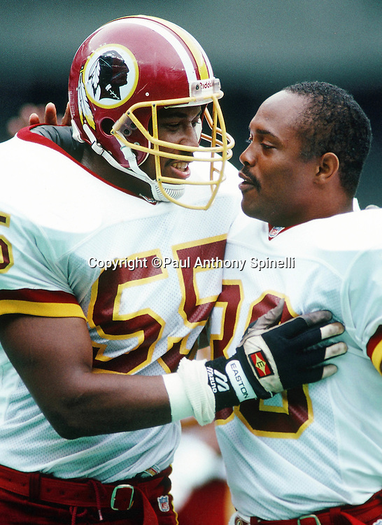 Washington Redskins linebacker Andre Collins (55) celebrates with Washington Redskins punt returner Brian Mitchell (30) after Mitchell returns a punt 66 yards for a touchdown during the NFL football game against the Cincinnati Bengals on Sunday, Sept. 22, 1991 in Cincinnati. The Redskins won the game 34-27. (©Paul Anthony Spinelli)