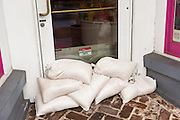 A closed store with sandbags to protect from flooding as Hurricane Joaquin brings heavy rain, flooding and strong winds as it passes offshore October 4, 2015 in Charleston, South Carolina.