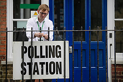 © Licensed to London News Pictures. 08/06/2017. London, UK. A polling station sign being hung up before Leader of the Labour Party Jeremy Corbyn votes at a school in his constituency of Islington North in London. Earlier this year British prime minister Theresa may Prime Minister Theresa May received the necessary two-thirds majority vote in parliament to call a snap election. Photo credit: Ben Cawthra/LNP