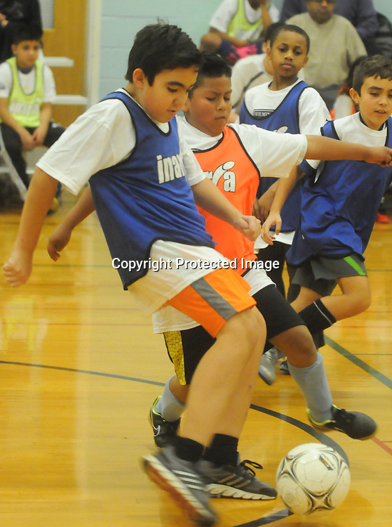 Fernando Garzon dribble the ball during the Wilmington Hammerheads' Youth Outreach Indoor Friendly Tournament Sunday January 11, 2015 at the MLK Center in Wilmington, N.C. (Jason A. Frizzelle)