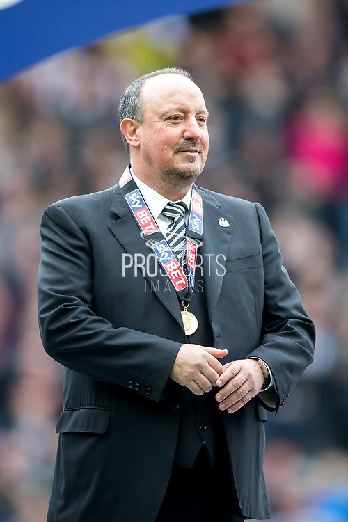 Newcastle United manager Rafael Benitez stands wearing his EFL Sky Bet Championship winners medal following the EFL Sky Bet Championship match between Newcastle United and Barnsley at St. James's Park, Newcastle, England on 7 May 2017. Photo by Craig Doyle.