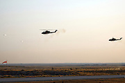 two Israeli Air force helicopter, Bell AH-1 Cobra in flight firing off a pair of air to ground missiles