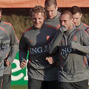 NLD/Katwijk/20110321 - Training Nederlandse Elftal Hongarije - NLD, warming up, Raphael van der Vaart, Dirk Kuyt, Wesley Sneijder